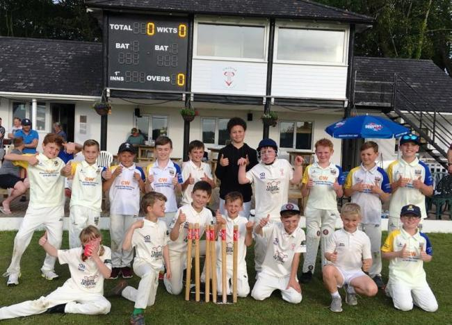 Llechryd and Laugharne Under 11s take a photo call in front of the new digital scoreboard