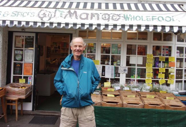 Charity marathon runner Ray Hasler outside his wholefood shop in Cardigan