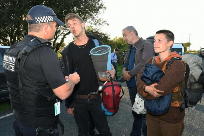 Officers speak with protesters after the action ends. PICTURE: Martin Cavaney