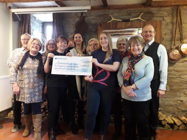 The Daffodil Inn friendship group, with match-funding from Barclays Bank, hands over the cheque to Jordan Harbin from Alzheimer's Society Cymru