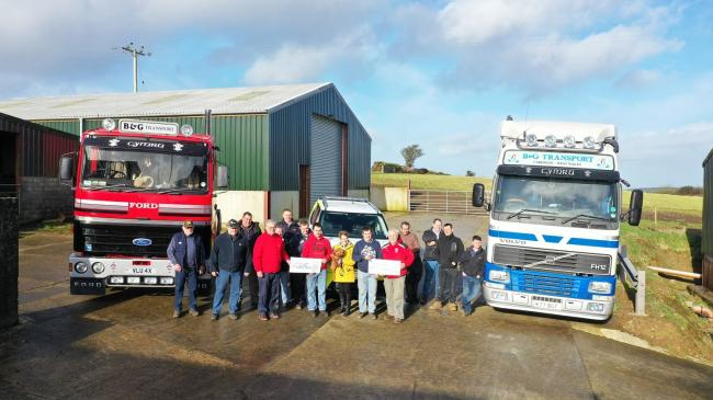 Organisers of the Gareth Thomas memorial truck run hand over £5,000 to charity