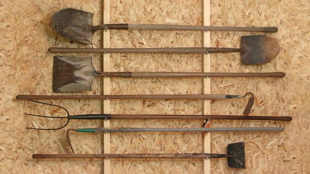 Tivyside Advertiser: Get heavy tools, rakes, shovels, etc., off the floor using utility hooks or, even, nails. Credit: Getty Images / Twoellis