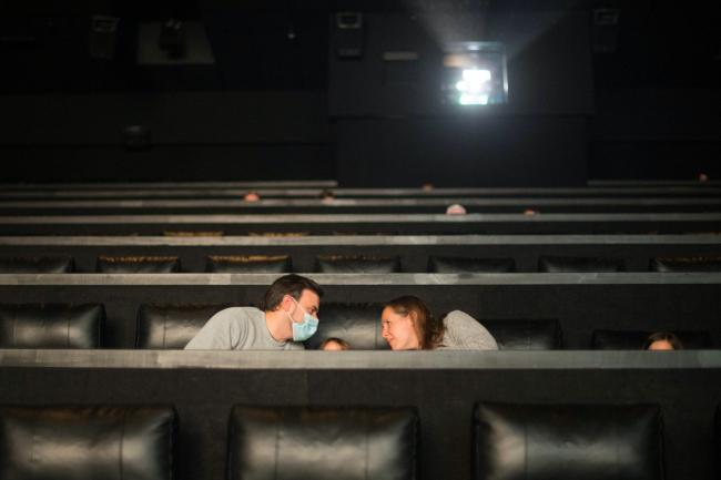 A socially distanced audience in a cinema