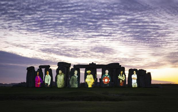 Tivyside Advertiser: The 5,000-year-old sarsen stones of Stonehenge have been illuminated with images of unsung heritage champions from across the UK, who with the help of National Lottery funding, have kept heritage accessible during the pandemic and beyond