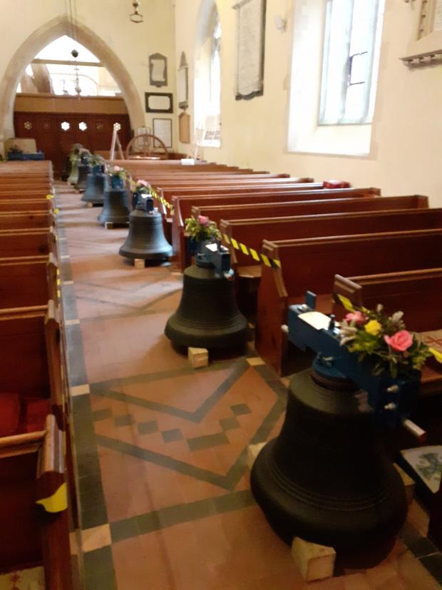 Tivyside Advertiser: The bells are laid out along the aisle at St Brynach's Church, Nevern