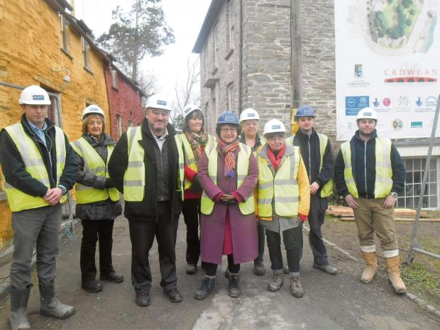 Ceredigion AM Elin Jones with Cadwgan trustees and site contractors at Cardigan Castle