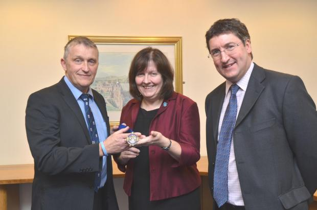 Cath Ranson with her Chain of Office at County Hall along with Councillor Rob Lewis (left) and Hywel Jones (right), Head of Planning. (3725974)