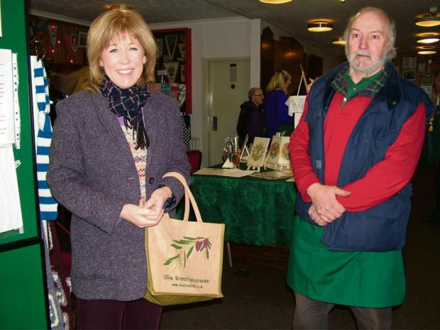 Sara Edwards is pictured with the market's chairperson Ian Goddard.