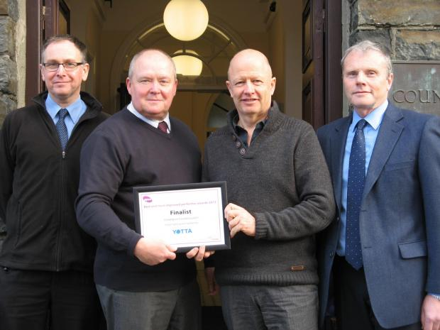 Pictured (from left to right): Alun Davies, Principal Engineer, Projects; Neil Garrod, Head of Street Lighting; Cllr. Alun Williams, Ceredigion County Council Cabinet Member; and Evan Pugh, Engineering Asset Manager.