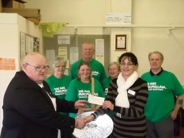 County Organiser, Eric Harries presenting Sue Reece (of Macmillan) with the cheque with some players looking on