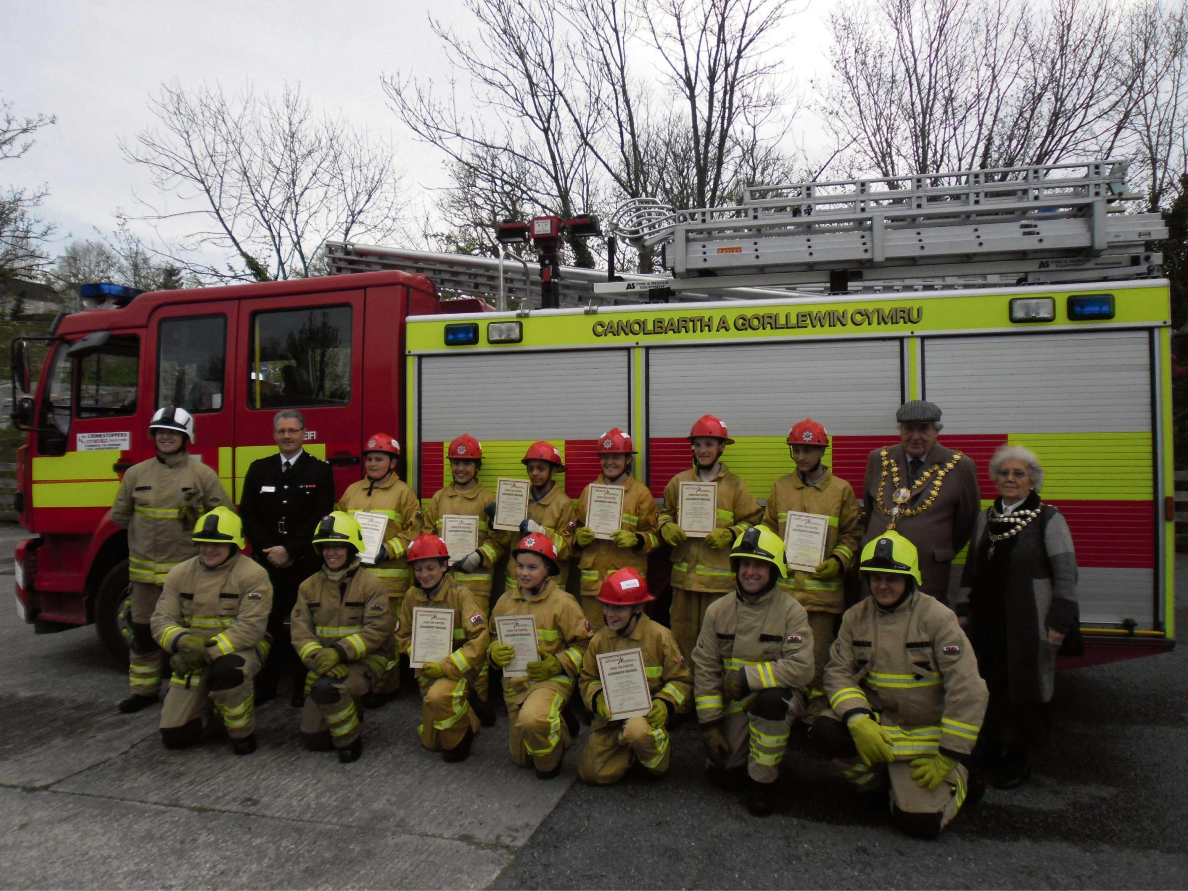 Young firefighters at the ceremony with mayor and mayoress of