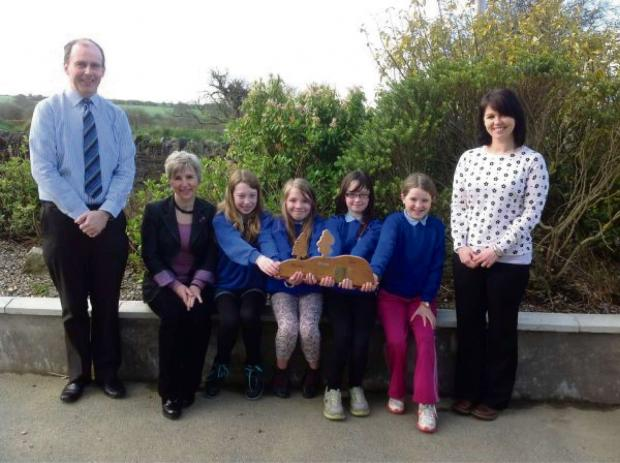 Pictured with pupils are (left to right) Sion Jones, Headteacher, Janie Pridham, Sustainable Schools Officer, and Catrin Davies, Deputy Headteacher. (6034069)