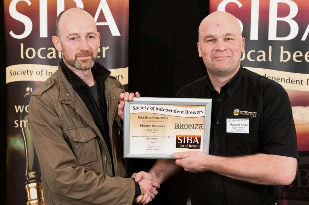 Director & Brewer, Ian Kimber (left) collects the award for Mantle Brewery Dark Heart.