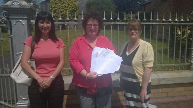 Elin Jones AM being presented with the children's letters by Teresa Harris and Gwyneth Morris of the Maesglas playing field campaign.