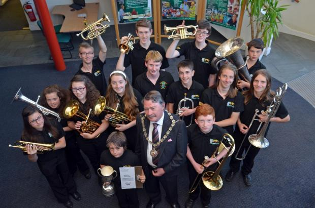 Tivyside Advertiser: Some of the young brass band members at County Hall with Chairman Councillor Tom Richards. (7181315)