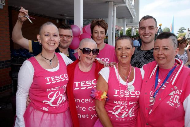 Tesco Ladies had their head shaved by Jay Bura and Jamie Castle of oojufink on Saturday. Left to right :  Gill Coombs, Diane Venton, Joy Sutton and Vicky Evans and Julie Worrall behind. Emyr Rhys Williams  (7670333)