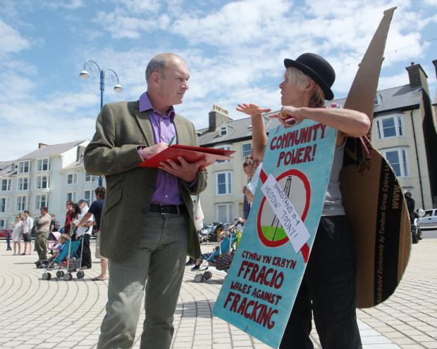 Mike Parker signing the declaration against fracking in Ceredigion, with anti-fracking campaigner Lotte Reimer