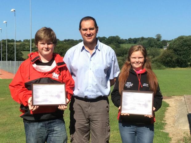Sophie and Kieran Edwards from Cardigan receiving their awards from Steven Jones, Ceredigion Sports Council.   (8649695)