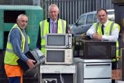 Pictured at the Civic Amenity and Recycling Centre are Supervisor David Riby, Richard Brown, and Cllr Huw George. (9776507)
