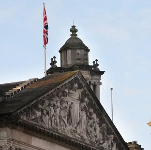 Martin McGuinness said the dispute over the flying of a Union flag over Belfast City Hall had caused a deterioration in relations