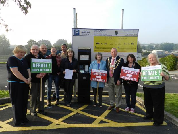 Town mayor Graham Evans, county councillor Catrin Miles and angry residents at Gloster Row car park