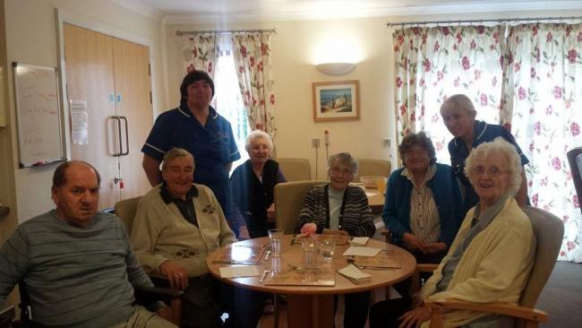 Senior Support Worker Helen Ghazal with residents of Maes Llewellyn Care Home who are all eagerly looking forward to the big – birthday celebration (42453961)