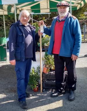 Tivyside Advertiser: Outgoing Newcastle Emlyn Country Market manager Pete Rout was presented with a rake by producers as a mark of thanks for his efforts.