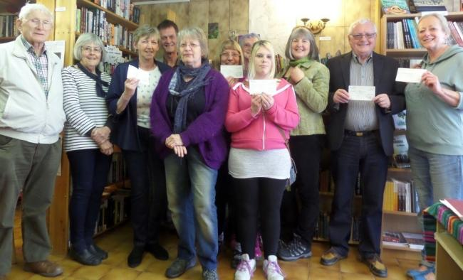 Volunteers from Leafed Through and representatives from local community groups who received cheques from the first distribution of surplus funds.