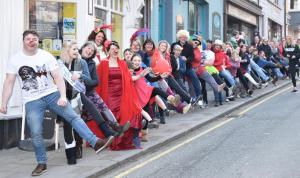Tivyside Advertiser: Cardigan mayor Clive Davies leads around 160 people through the streets in a conga in aid of Comic Relief