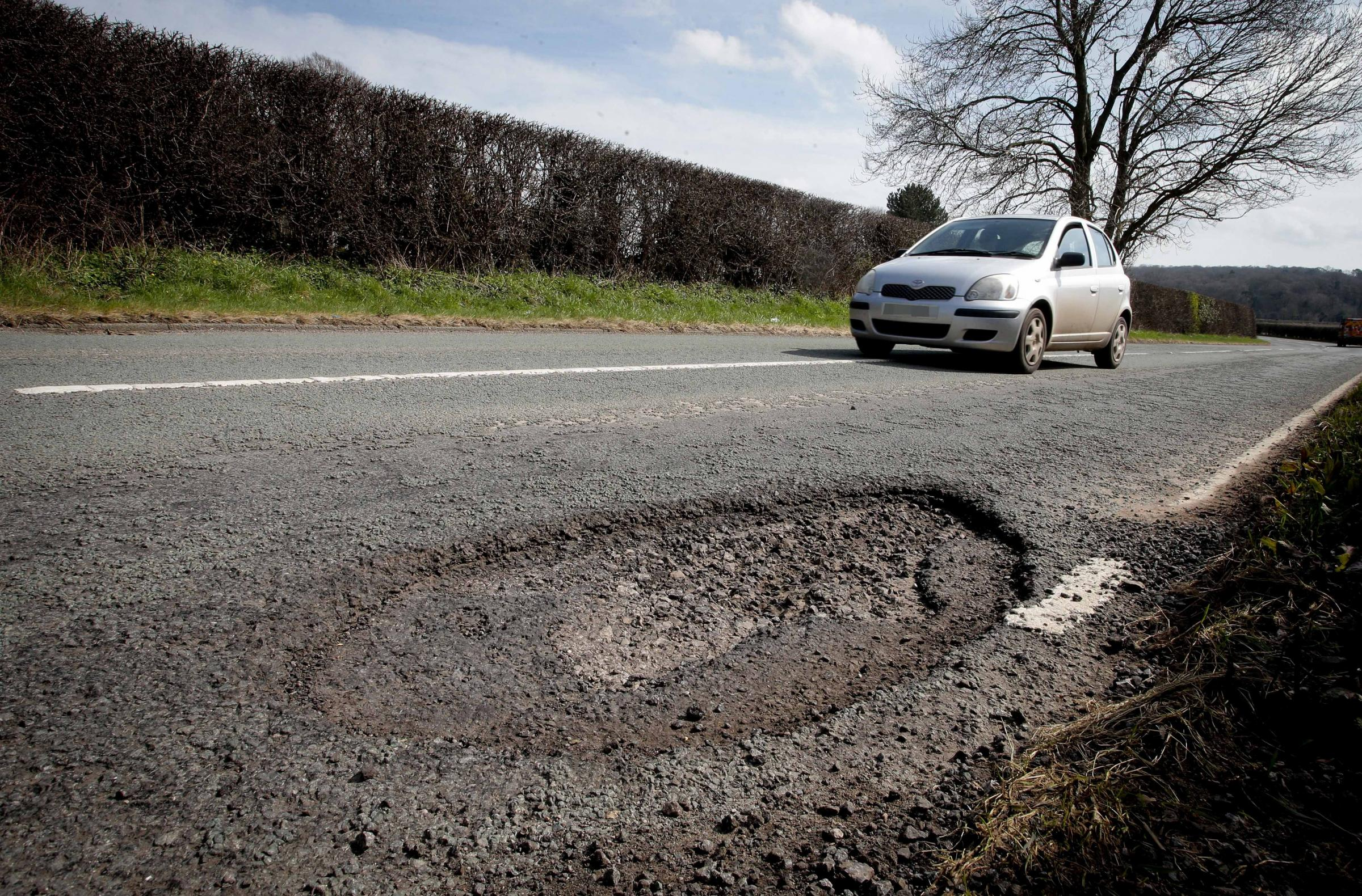 RM060418p.Mold.B5444 Wrexham Road.Pot hole - before and after.Flintshire County Council filling in the potholes.