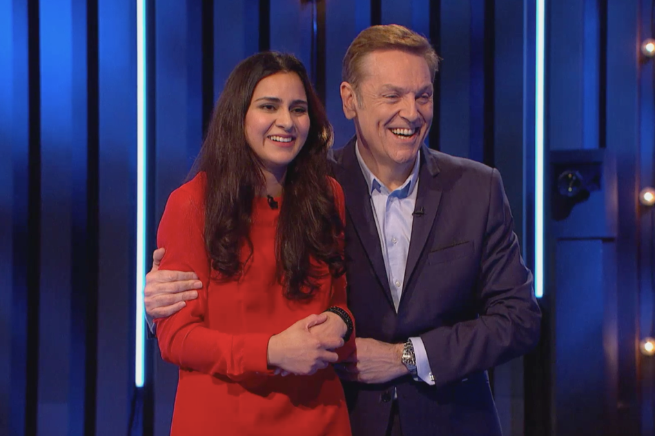 Buy It Now host Brian Conley with contestant Sylvia, who walked away with a life-changing order for her product (Channel 4/PA)