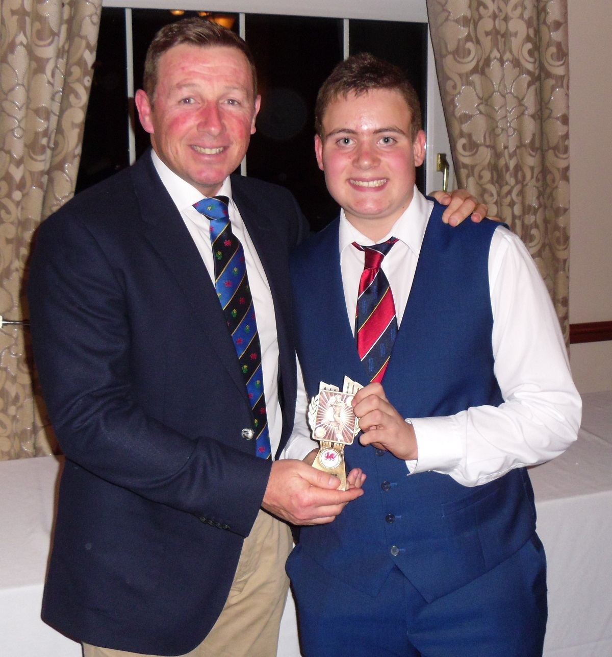 Dafydd Wyn Hatley receives a prize from former England cricket international a Glamorgan spin bowler Robert Croft for the most wickets in Division Six of the South Wales Cricket Association. Dafydd is a member of the Llandysul 2nd XI.