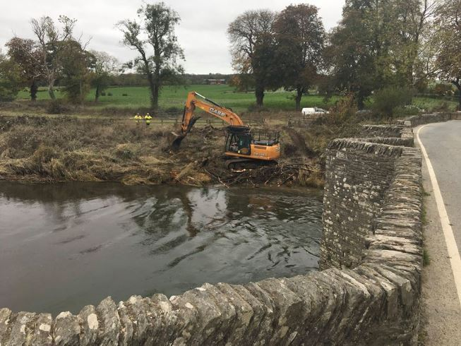 Work being carried out to clear the debris at Llechryd bridge across the River Teifi following the recent flooding. PICTURE: Clive Davies