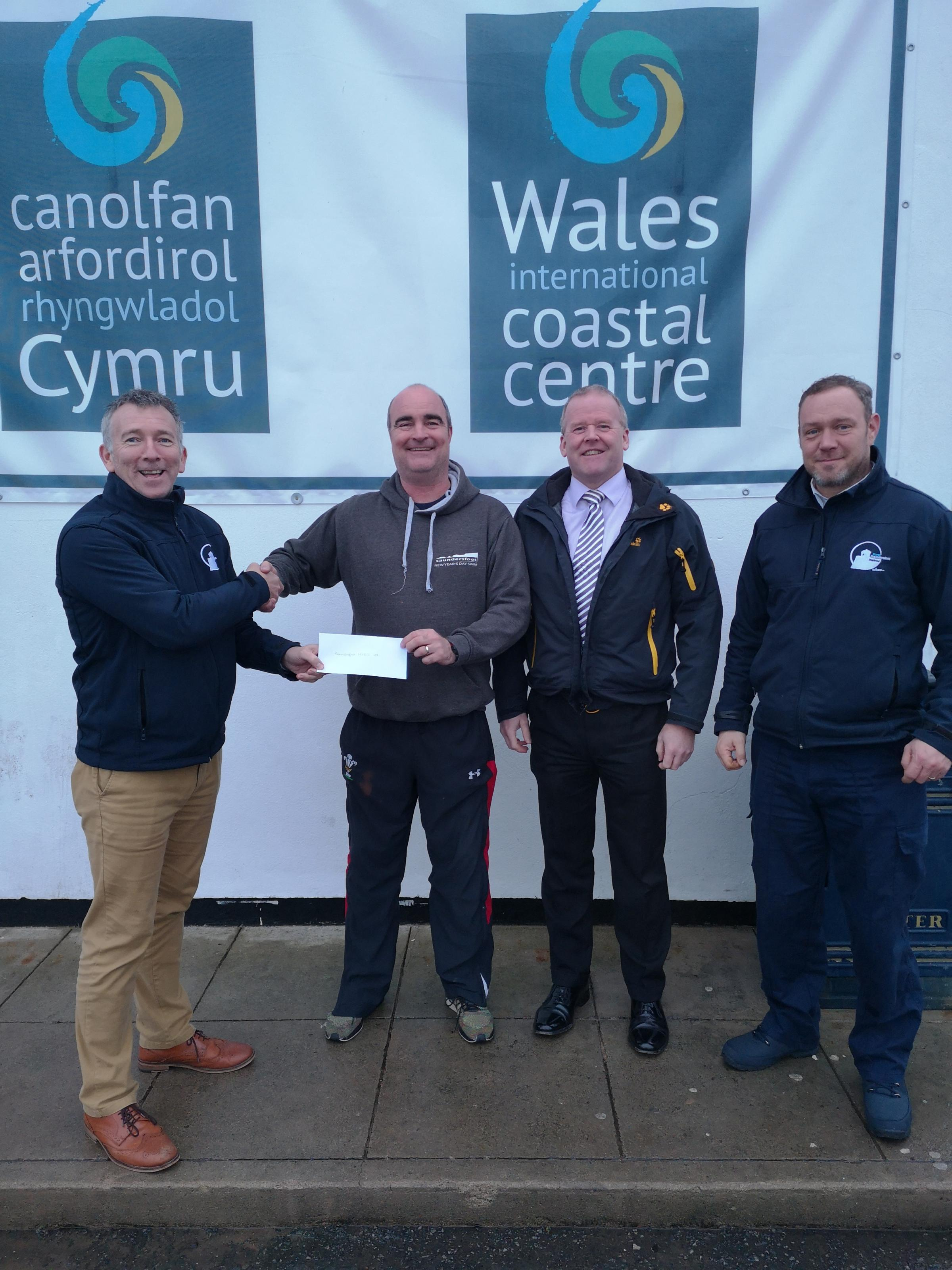 Pictured at the cheque presentation are: Bradley Davies, Saundersfoot Harbour commercial manager; Chris Williams, New Year's Day Swim Committee; Antony Matic, New Year's Day Swim Committee; and David Richards, Saundersfoot Harbourmaster.