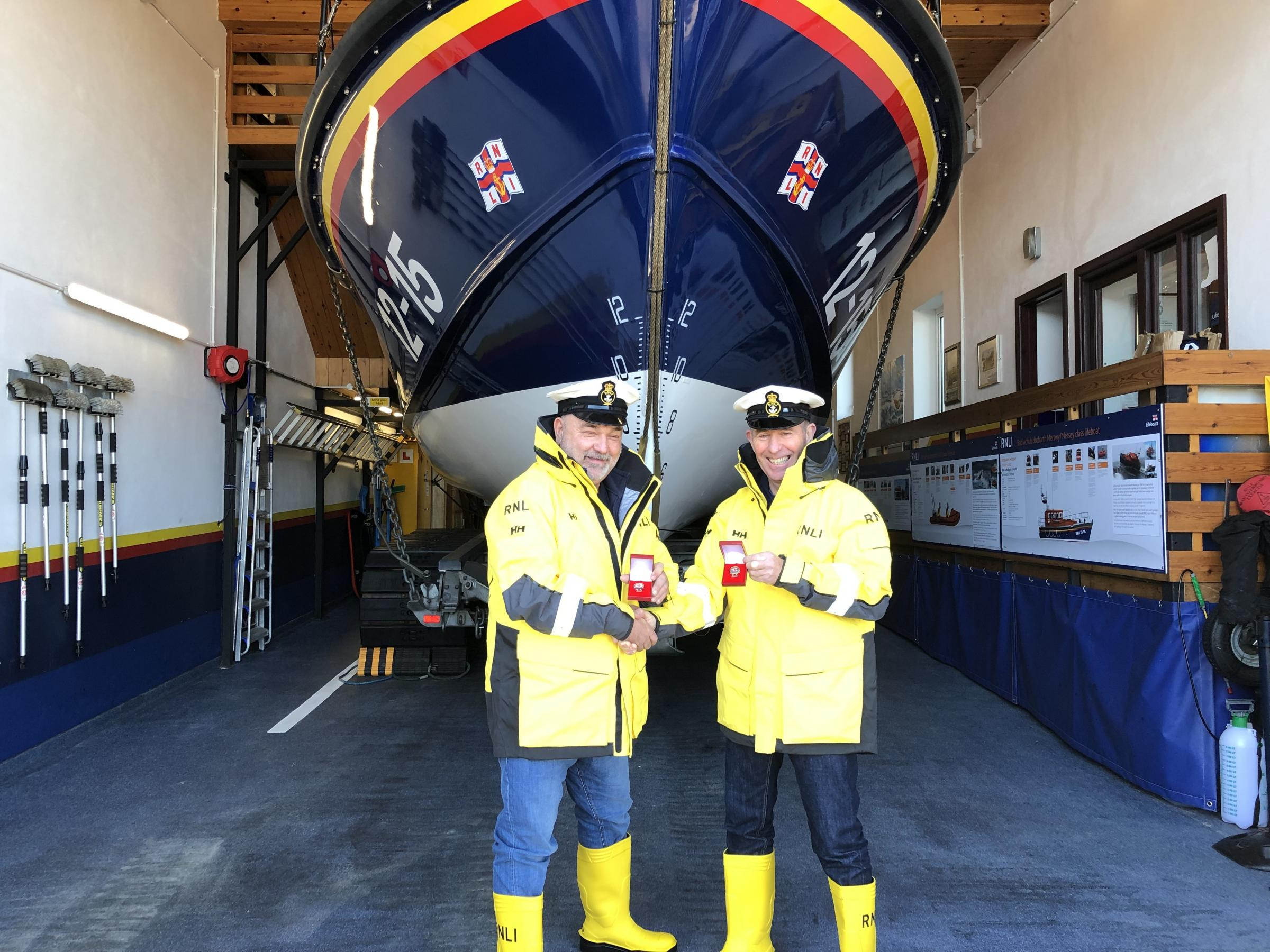 New Quay RNLI coxswain Daniel Potter (left) and second coxswain Steve Hartley with their awards