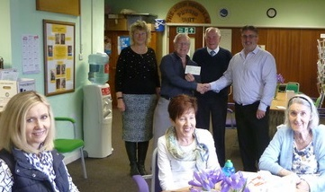 The Province of West Wales Freemasons present the cheque for £600 to the HOPE MS unit, Neyland.